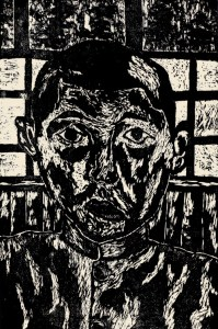 A woodcut print of a face.