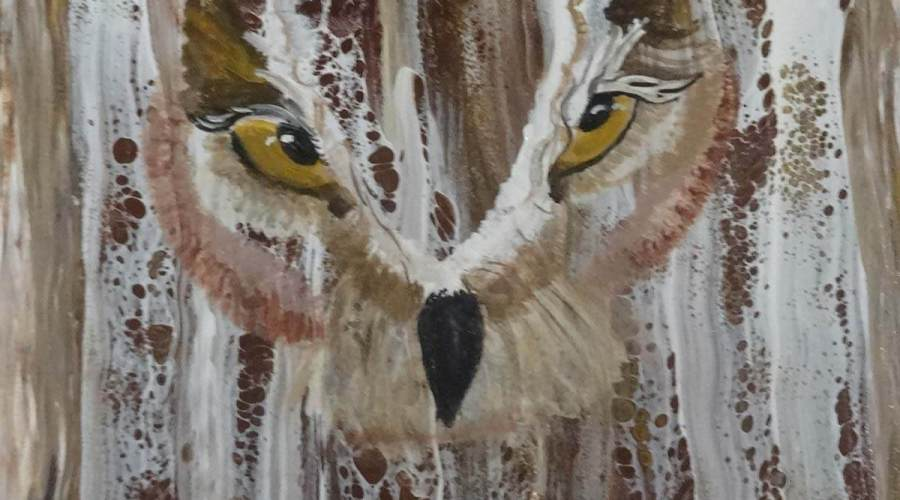 An acrylic painting of an owl with captivating yellow eyes.