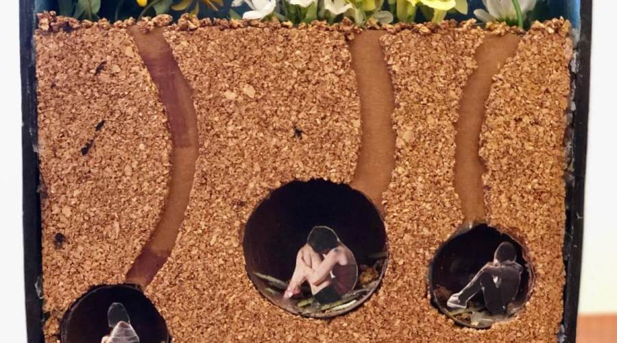 Mixed media piece of humans in burrows under the soil