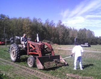 Picking up Sod from Drainage Furrow