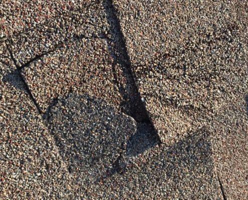 Damaged shingles on a home.