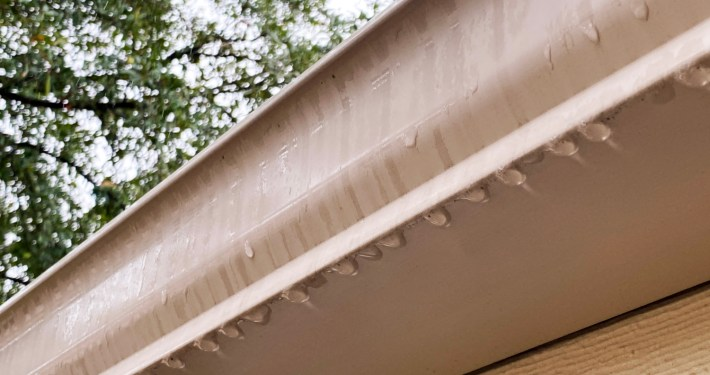 Raindrops On Gutter