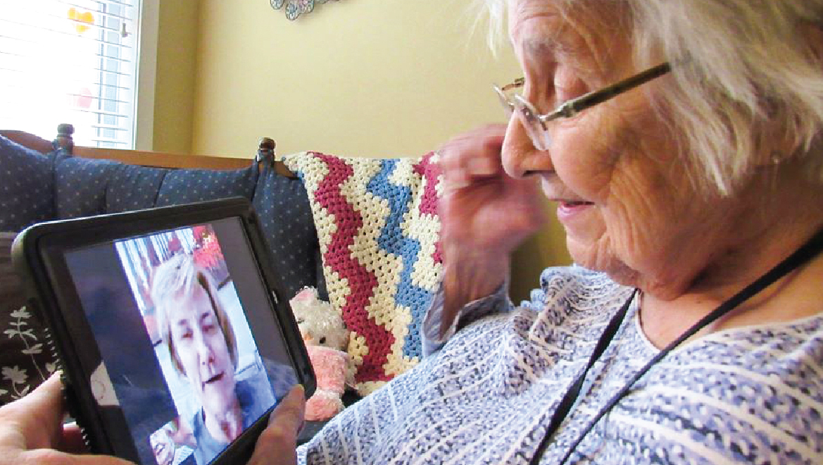 Female resident having a virtual visit with a friend