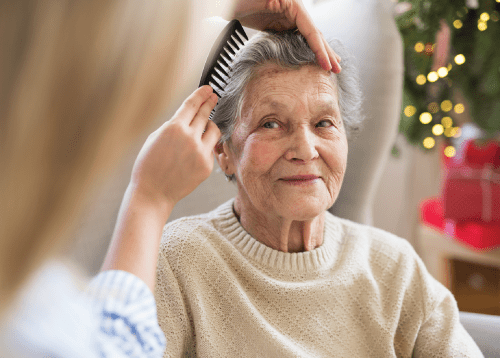 woman having her hair combed