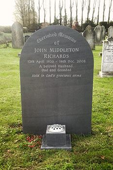 Hand cut lettering on late headstone