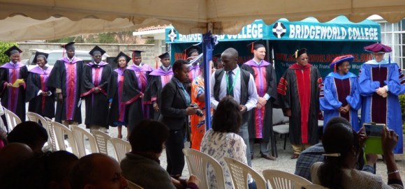 Lecturers lined up to congratulate graduates after they received their diplomas.