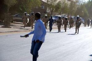 Sudanese Police chasing one of the protester because he fighting against Sudanese dirty government