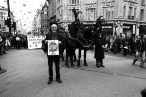 Donnachadh McCarthy, co-founder of Stop Killing Cyclists, stands in Oxford Circus, as part of the National Funeral for the Unknown Victim of Traffic Violence protest organised by the Stop The Killing coalition (Photo by Brendan Delaney, used with permission, click to see larger version)