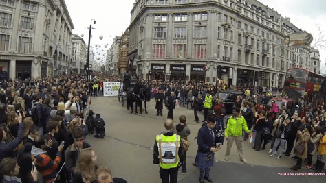 Thousands watched the horse-drawn hearse travel through Oxford Circus, as part of the National Funeral for the Unknown Victim of Traffic Violence protest organised by the Stop The Killing coalition (Photo by DrMorocho, used with permission, click to see larger version)
