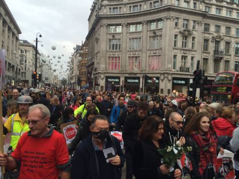 People by the hundreds marched through Oxford Circus, as part of the National Funeral for the Unknown Victim of Traffic Violence protest organised by the Stop The Killing coalition (Photo by Tom Kearney, used with permission, click to see larger version)