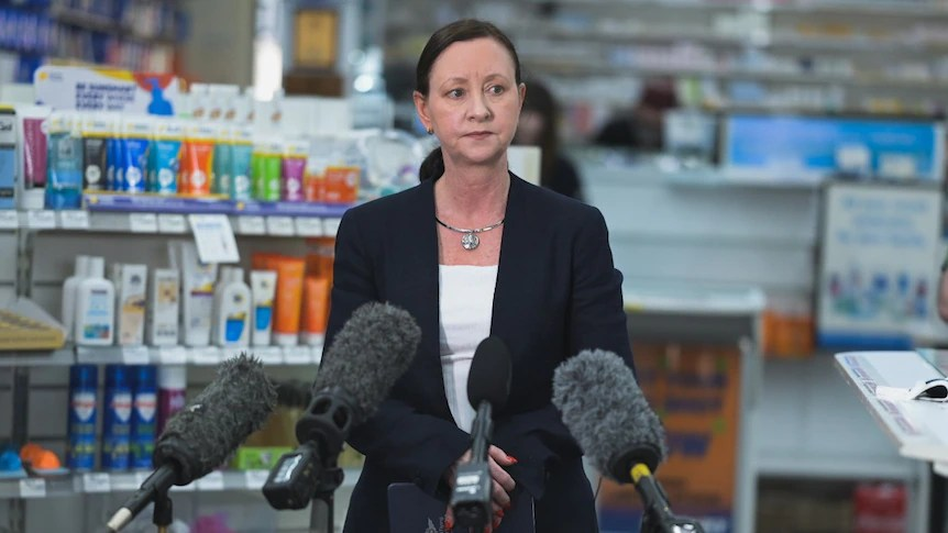 Yvette D'Ath gives a press conference in a pharmacy