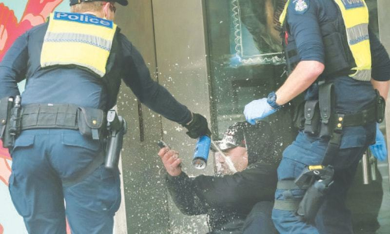 Violent protests against Covid curbs continue in Australian city - Newspaper