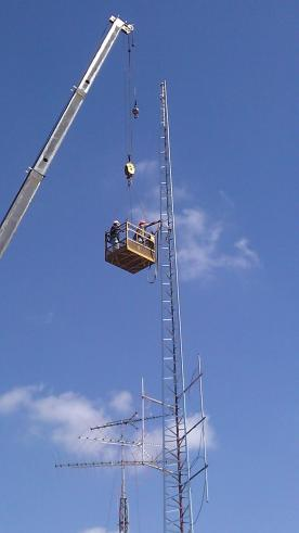 Installing a Wi-Fi tower to bring wireless Internet access to a resort park.