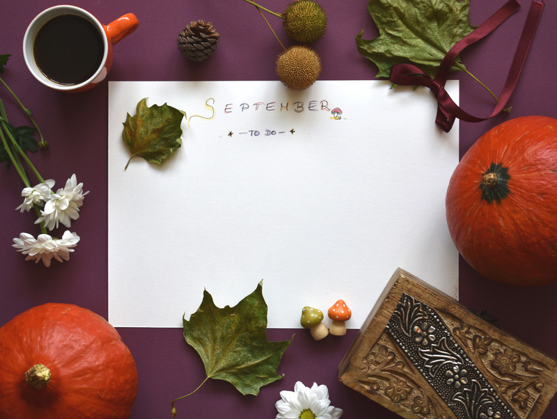 A September to-do list surrounded by an orange pumpkin, leaves, and white flowers. 10 steps to overcoming guilt.