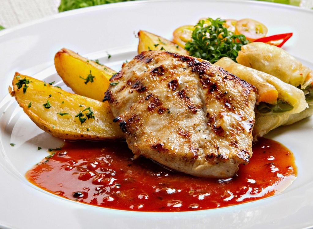 Chicken breast and potatoes in a red sauce on a white plate. Soft Foods Diet: Post Bariatric Surgery | Plus Five Recipes to Try!
