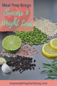 A table of food ingredients, like lemon, limes, split peas, garlic, and black peppercorns. Meal prep brings success and weight loss.