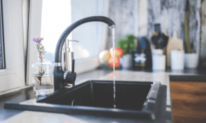 A gray sink with water coming out of the faucet on a countertop. How to Clean Your CPAP | Only 15 Minutes to Better Sleep