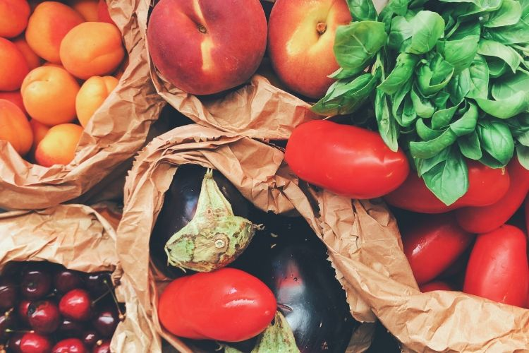 Brown sacks of produce, including apricots, peaches, basil, tomatoes, eggplant, and cherries. Your nutrition classes before bariatric surgery.