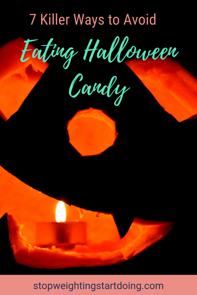 A jack-o-lantern lit with a candle inside. 7 Killer Ways to Avoid Eating Halloween Candy | Be a Halloween Superstar | Pinterest Image