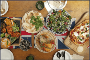 A spread of food on a table, including pizza, salad, quesadillas, and fried appetizers.   The Forbidden Foods You Need to Avoid After Bariatric Surgery   3 Types   Featured Image