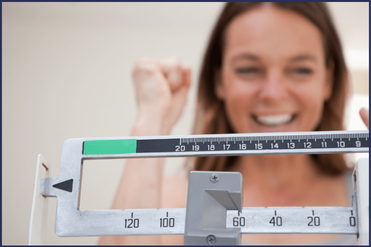 A woman celebrating her weight loss | Featured Image | | How to Determine Your Bariatric Surgery Success Rate: 6 Tips to Follow | Gastric Sleeve Success Rate, Bariatric Surgery Success