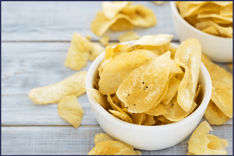 A bowl of chip overflowing onto a table. | 5 Simple Ways to Avoid Slider Foods After Bariatric Surgery | Let Go Now | Image | list of gastric sleeve slider foods