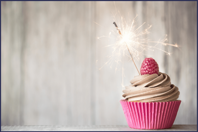 A cupcake in a raspberry wrapper with chocolate icing and a sparkler. Here Are the Top 20 Lessons I've Learned from Bariatric Surgery | Graphic | bariatric surgery, post-op, gastric sleeve