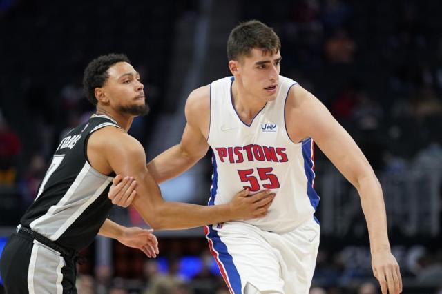 Detroit Pistons center Luka Garza (55) checks San Antonio Spurs guard Bryn Forbes (7) during the second half of a preseason NBA basketball game, Wednesday, Oct. 6, 2021, in Detroit. (AP Photo/Carlos Osorio)