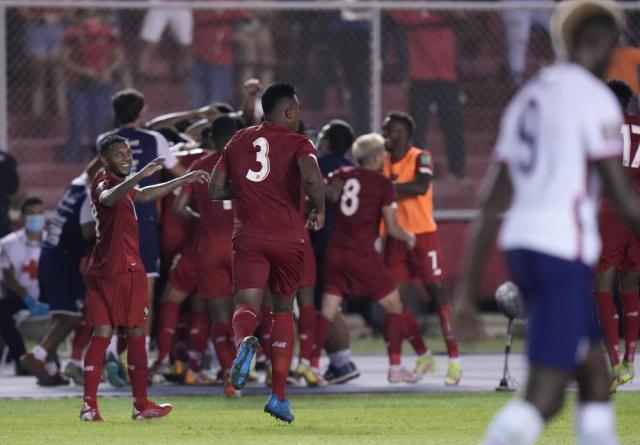 Panama's Anibal Godoy celebrates with teammates after scoring his side's opening goal against United States during a qualifying soccer match for the FIFA World Cup Qatar 2022 at Rommel Fernandez stadium, Panama city, Panama, Sunday, Oct. 10, 2021. (AP Photo/Arnulfo Franco)