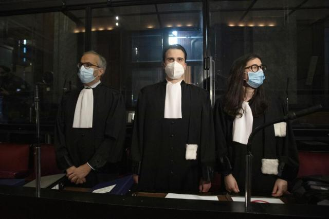 Lawyers for AstraZeneca Clemence Van Muylder, right, and Hakim Boularbah, left, wait for the start of a hearing, European Commission vs AstraZeneca, at the main courthouse in Brussels, Wednesday, May 26, 2021. The European Union took on vaccine producer AstraZeneca in a Brussels court on Wednesday with the urgent demand that the company needs to make an immediate delivery of COVID-19 shots the 27-nation bloc insists were already due. (AP Photo/Virginia Mayo)