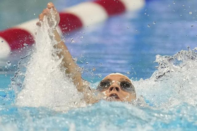 Rhyan White participates in the women's 200 backstroke during wave 2 of the U.S. Olympic Swim Trials on Saturday, June 19, 2021, in Omaha, Neb. (AP Photo/Charlie Neibergall)