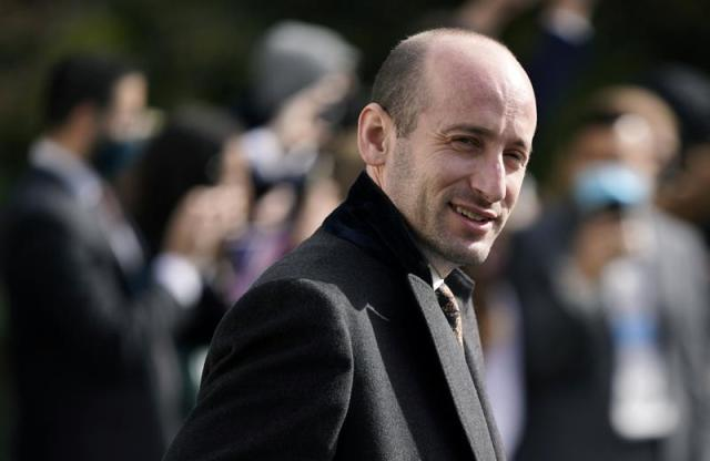 FILE - In this Oct. 30, 2020, file photo, then-President Donald Trump's White House senior adviser Stephen Miller walks on the South Lawn of the White House in Washington. Tens of thousands of Afghan refugees fleeing the Taliban are arriving in the U.S., and a handful of former Trump administration officials are working to turn Republicans against them. (AP Photo/Patrick Semansky, File)