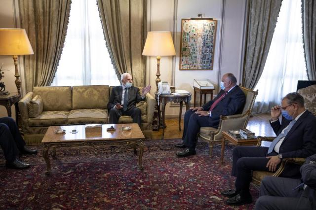Egyptian Foreign Minister Sameh Shoukry, second right, meets with Palestinian Fatah official Azzam Al-Ahmad at the foreign ministry in Cairo, Thursday, May 20, 2021. (AP Photo/Nariman El-Mofty)