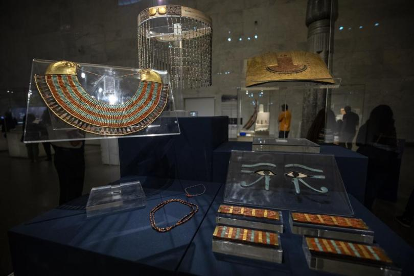 FILE - In this April 24, 2021 file photo, a collection of the jewelry of Princess Neferuptah, the daughter of King Amenemhat III, on display in its glass case at the new National Museum of Egyptian Civilization in Old Cairo.   As some European countries re-open to international tourists, Egypt has already been trying for months to attract them to its archaeological sites and museums. Officials are betting that the new ancient discoveries will set it apart on the mid- and post-pandemic tourism market(AP Photo/Nariman El-Mofty, File)
