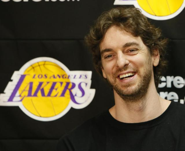FILE - In this April 30, 2013 file photo, Los Angeles Lakers power forward Pau Gasol smiles while talking to reporters during an NBA basketball news conference in El Segundo, Calif. Pau Gasol announced his retirement from basketball on Tuesday,  Oct. 5, 2021, ending a career that lasted more than two decades and earned him two NBA titles and a world championship gold with Spain's national team. (AP Photo/Damian Dovarganes, File)