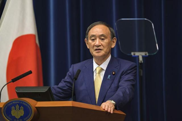 Japan's Prime Minister Yoshihide Suga speaks during a press conference at his official residence in Tokyo Thursday, July 8, 2021. Suga declared the fourth state of emergency would go in effect on Monday and last through Aug. 22. This means the Olympics, opening on July 23 and running through Aug. 8, will be held entirely under emergency measures. (Nicolas Datiche/Pool Photo via AP)