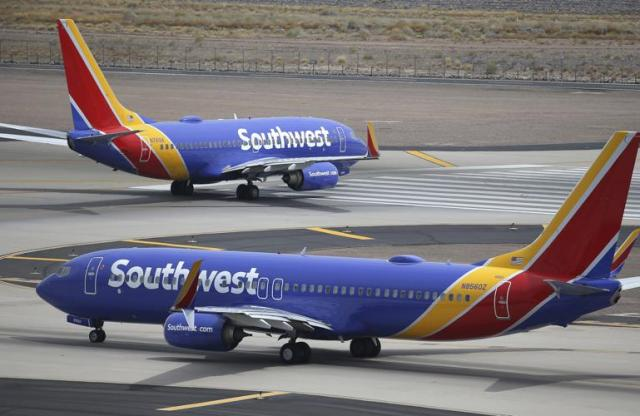 FILE - This July 17, 2019 file photo shows Southwest Airlines planes at Phoenix Sky Harbor International Airport in Phoenix. Southwest Airlines President Tom Nealon, who was once seen as a leading candidate for CEO but was passed over this year, has retired. Southwest said Monday, Sept. 13, 2021, that Nealon, 60, will still serve as an adviser focusing on environmental issues, including plans to reduce carbon emissions. (AP Photo/Ross D. Franklin, File)