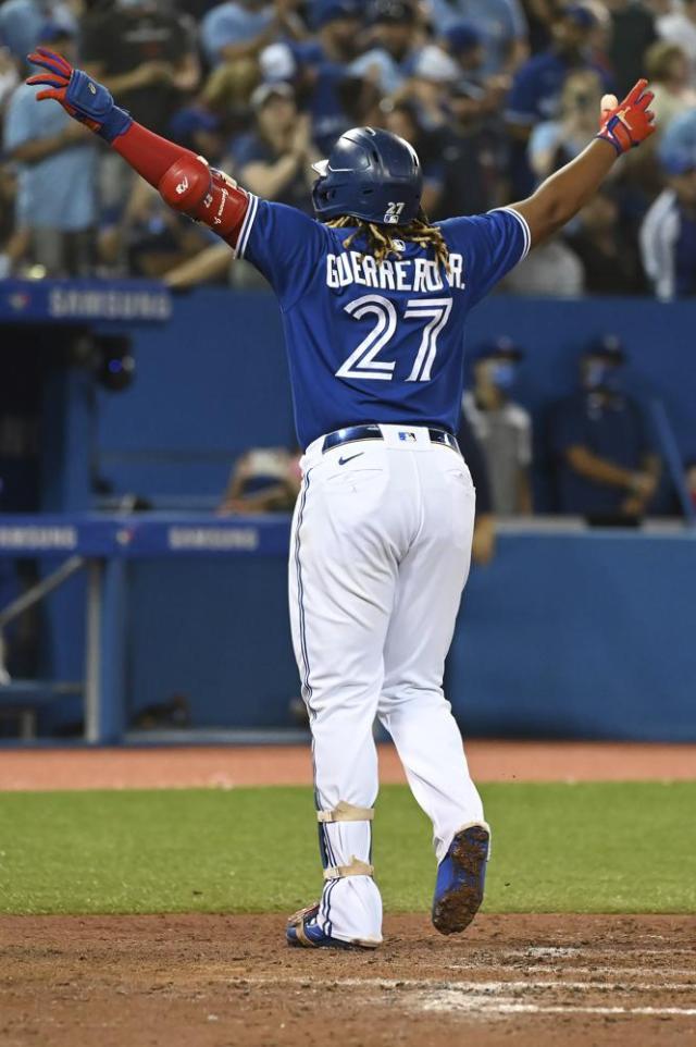 Toronto Blue Jays' Vladimir Guerrero Jr. celebrates his solo home run against the Minnesota Twins during the third inning of a baseball game Friday, Sept. 17, 2021, in Toronto. (Jon Blacker/The Canadian Press via AP)