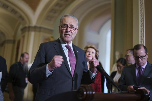 Senate Majority Leader Chuck Schumer, D-N.Y., speaks to reporters before meeting with Democratic members of the Texas Legislature who are trying to kill a Republican bill in Austin that would make it harder to vote in the Lone Star State, at the Capitol in Washington, Tuesday, July 13, 2021. (AP Photo/J. Scott Applewhite)