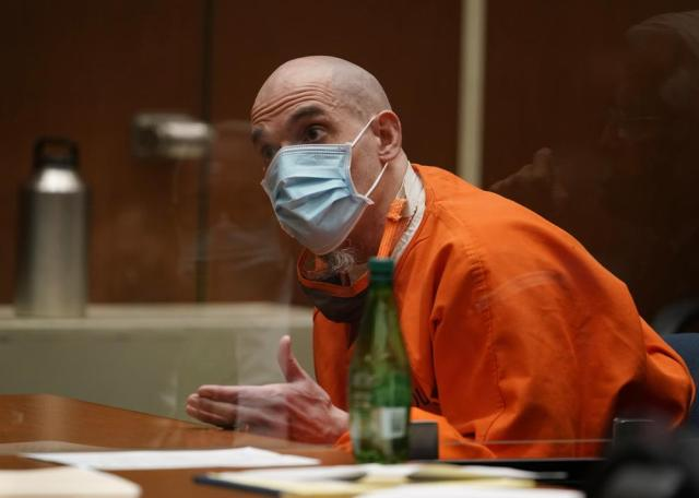 """Michael Thomas Gargiulo speaks before his sentencing, angrily complaining that his lawyers prevented him from taking the stand in his defense at Los Angeles Superior Court, Friday, July 16, 2021. """"I'm going to death row wrongfully and unjustfully,"""" said Gargiulo, who showed no visible reaction to his sentencing. """"I did want to testify and my fundamental choice was blocked."""" For crimes he called """"vicious and frightening,"""" a judge on Friday gave a death sentence to Gargiulo who prosecutors called """"The Boy Next Door Killer"""" for the home-invasion murders of two women and the attempted murder of a third. (AP Photo/Damian Dovarganes)"""