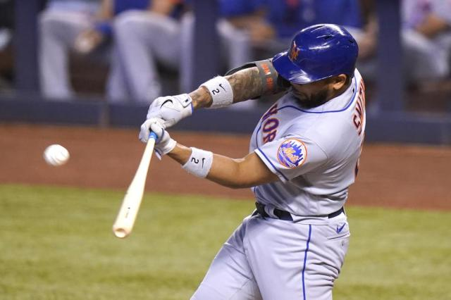 New York Mets' Dominic Smith flies out to left field during the third inning of a baseball game against the Miami Marlins, Saturday, May 22, 2021, in Miami. (AP Photo/Lynne Sladky)