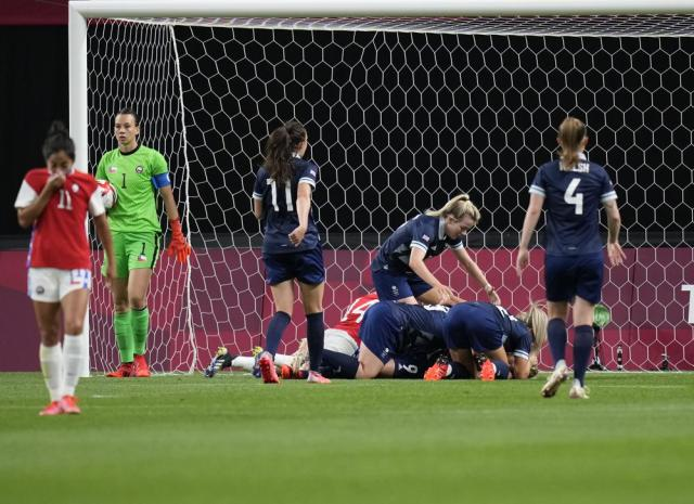 Players of Britain celebrate after Ellen White scoring their side's opening goal against Chile during a women's soccer match at the 2020 Summer Olympics, Wednesday, July 21, 2021, in Sapporo, Japan. (AP Photo/Silvia Izquierdo)