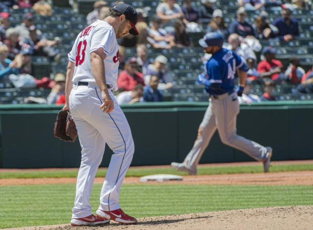 Cleveland Indians starting pitcher Aaron Civale kicks the mound after giving up a solo home run to Toronto Blue Jays' Rowdy Tellez, right, during the fourth inning of the first baseball game of a doubleheader in Cleveland, Sunday, May 30, 2021. (AP Photo/Phil Long)