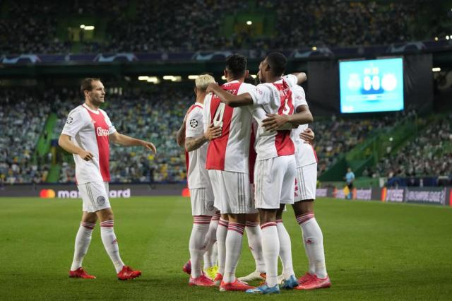 Ajax players celebrate after Sebastien Haller scored his side's opening goal during a Champions League, Group C soccer match between Sporting CP and Ajax at the Alvalade stadium in Lisbon, Wednesday, Sept. 15, 2021. (AP Photo/Armando Franca)