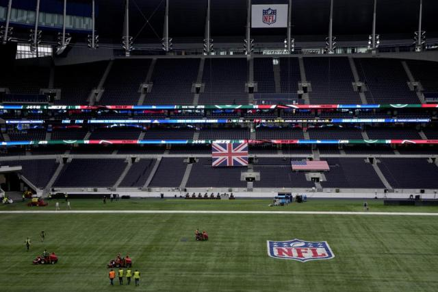 Workers prepare the pitch in preparation to host NFL at the Tottenham Hotspur Stadium in London, Thursday, Oct. 7, 2021. After a one-year hiatus due to the pandemic, the NFL returns to London on Sunday when the Atlanta Falcons play the New York Jets at Premier League club Tottenham's $1.6 billion facility (AP Photo/Kirsty Wigglesworth)