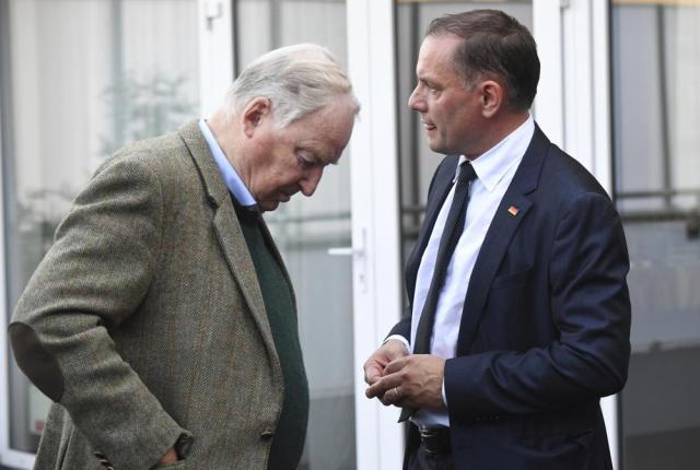 Afd's top candidate Tino Chrupalla, right, and Alexander Gauland, chairman of the Afd parliamentary group, stand on the sidelines of an Afd election party for the federal election as they wait for the first forecasts on the outcome of the election, in Berlin, Sunday, Sept. 26, 2021. German voters are choosing a new parliament in an election that will determine who succeeds Chancellor Angela Merkel after her 16 years at the helm of Europe's biggest economy.  (Julian Stratenschulte/dpa via AP)
