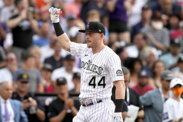 National League's Trevor Story, of the Colorado Rockies, waves during the first round of the MLB All Star baseball Home Run Derby, Monday, July 12, 2021, in Denver. (AP Photo/David Zalubowski)