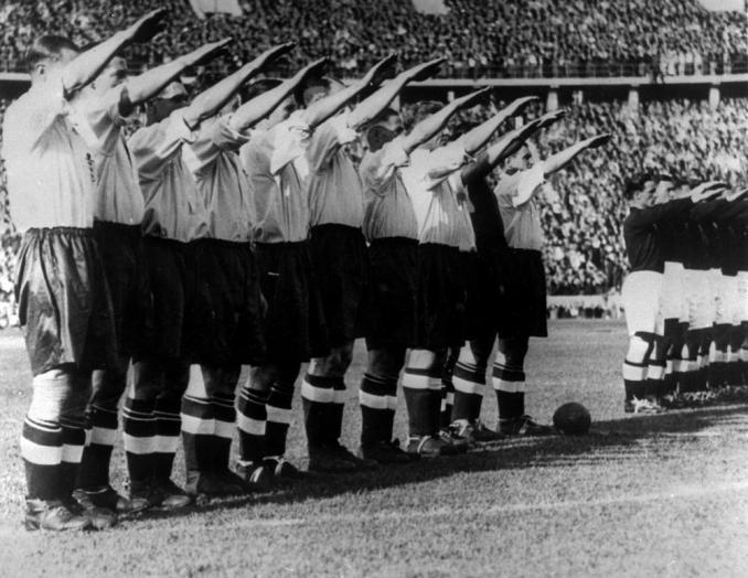 FILE - In this May 14, 1938 file photo the England soccer team give the Nazi salute before the start of their game against Germany in front of a record crowd of over 100,000 at the Olympic Stadium in Berlin. England defeated Germany 6-3. One of the great rivalries in international soccer will be renewed on Tuesday at the European Championship when England plays Germany in the round of 16 at Wembley Stadium. The teams have played some epic matches in the past, including in the 1966 World Cup final and in the semifinals at Euro '96. They each won one of those matches, but overall the Germans lead with 15 victories, 13 losses and four draws.(AP Photo)