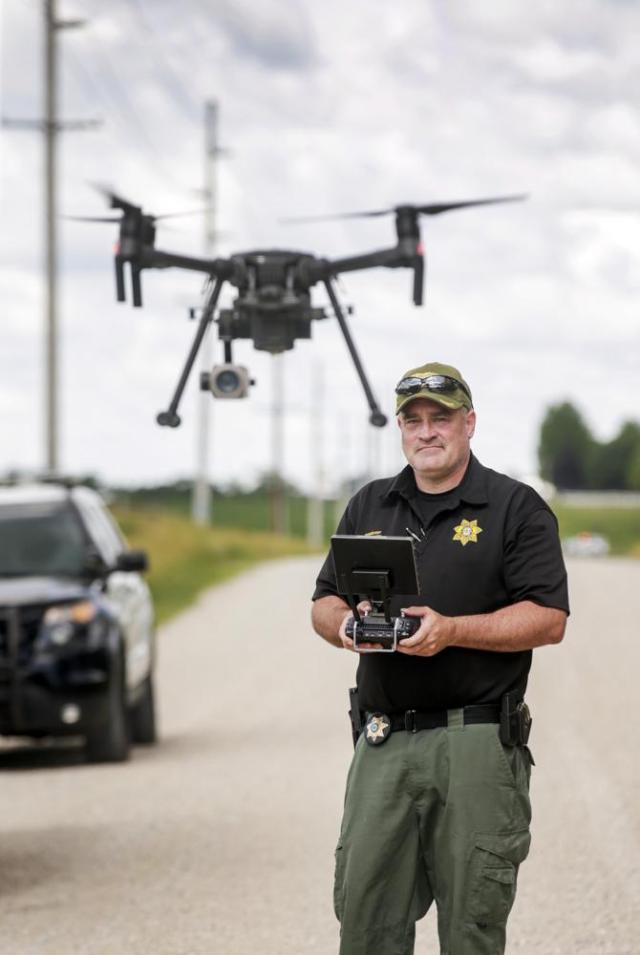 Linn County Sheriff's Office Sgt. Pat Brady pilots a UAV to search for a robbery and shooting suspect in Coggon, Iowa, on Monday, June 21, 2021. A Linn County Sheriff's Office deputy was shot multiple times by an armed suspect upon entering the Casey's, 5110 Highway 13, in Coggon while responding to a robbery alarm. (Jim Slosiarek/The Gazette via AP)