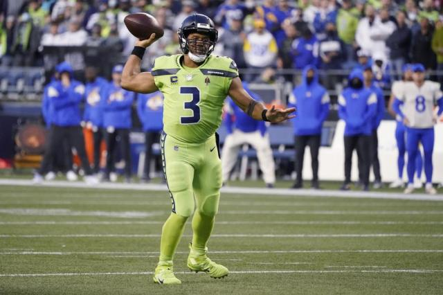 Seattle Seahawks quarterback Russell Wilson passes against the Los Angeles Rams during the first half of an NFL football game, Thursday, Oct. 7, 2021, in Seattle. (AP Photo/Elaine Thompson)